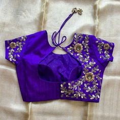 Purple floral pattern hand zardosi work Designer wedding saree lehenga blouses To inquire whatsapp 918888328116 or ethnicdiagmailcom Pattu Saree Blouse Designs, Fancy Blouse Designs, Bridal Blouse Designs, Blouse Back Neck Designs, Stylish Blouse Design, Trendy Sarees, Work Blouse, Zardosi Work, Lehenga