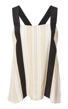 This Zeus + Dione Leto Graphic Top features a graphic linear strap top cut of textured silk fabric.