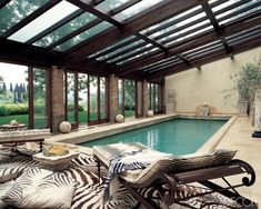 Fashion designer Roberto Cavalli's pool with a hillside view at his home in Tuscany, Italy. I would lounge and swim all day in this room, even when it is raining outside.