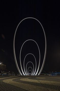 The Elizabeth Quay lighting design is a fully integrated architectural and landscape system designed to mirror the cultural connection of Perth City to the Swan River. Led lighting provides efficient minimal maintenance benefits whilst strategically highlighting the area's native plants. Not to be forgotten, the Quays largest sculpture standing at 29m, The Spanda is surrounded by LED lighting ensuring it's precedence over the public space.