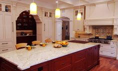 Beautiful kitchen in white with a lovely kitchen island, I just love to have this. :-)