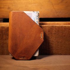 Simple leather wallet. Front pocket. Clean.
