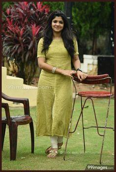 Aparna Balamurali Beautiful HD Photoshoot Stills Salwar Designs, Sari Blouse Designs, Kurta Designs Women, Dress Neck Designs, Kurti Designs Party Wear, Churidhar Designs, Salwar Pattern, Kurti Embroidery Design, Dress Indian Style