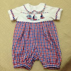 Boy's romper embroidered with 3 cross stitch sail boats.