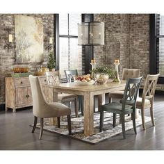 I love this table with mix up chairs.