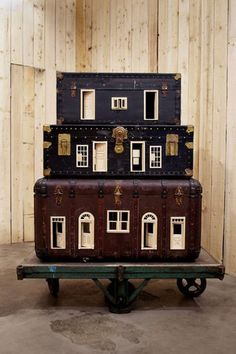 These are amazing! Dollhouses made out of suitcases, by Swedish artist Christian Larsson (shown: Mobile Home)