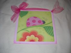 "Pink Ladybug on a Branch Girls Bedroom Wooden Wall Art Sign by The Little Store of Home Decor. $8.99. size 9x9. made in the USA. We've sealed this ladybug art print onto wood giving it a framed appearance. We've painted the wood a pretty pale pink color with touches of darker pink to accent the print. It measures approximately 9"" squared by 1/4"" thick. We've added a bright pink ribbon for easy hanging and added charm."