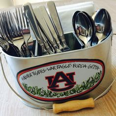 Everyone loves finger foods, but sometimes you just need flatware. Whether you're hosting a tailgate or having friends over for a barbecue, set the table in style with our Metal Auburn Utensil Holder. This galvanized metal utensil holder has room for knives, forks, spoons and napkins, and is full of Auburn pride! Plus, with the removable insert, you can use it for other items when flatware just isn't needed.