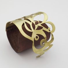 "Cuff | Janine Golbert ~ eninaj designs.  ""Tattoo"".  Brass and leather"