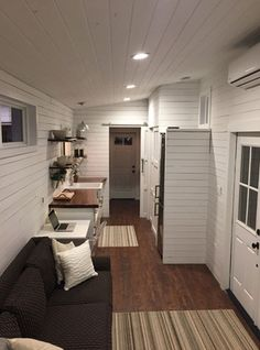 Brian and Skyler's Fifth Wheel Tiny House design is comfortable and gorgeous. The young couple shares their story, photographs and space saving design tips.