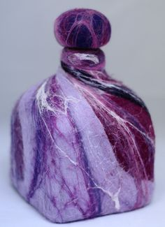 I've seen felting around soap, but never around a bottle - this is great!