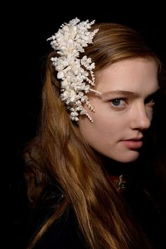 White flower hairpiece backstage at Gucci AW15 MFW. See more here: http://www.dazeddigital.com/fashion/article/23825/1/gucci-aw15-livestream