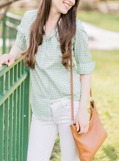 This cute spring outfit features all of my spring style essentials from Kohl's! I paired this Chaps no-iron green gingham shirt with Levi's white ankle skinny jeans, Madden NYC nude Ellsaa wedges, and a saddle LC Lauren Conrad ring convertible crossbody bag that converts to a fold-over clutch   Cute spring outfits for women   Pastel Lookbook: Spring Style Picks from Kohl's by southern fashion blogger Stephanie Ziajka from Diary of a Debutante #kohls #lclaurenconrad #springstyle