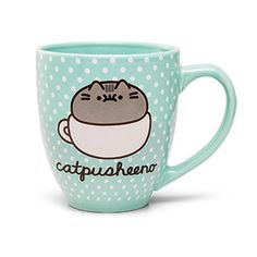 """With this Catpusheeno Mug, your relaxing cup of tea will be plentiful and charming. While sitting atop a coffee cup herself, Pusheen's """"catpusheeno"""" persona is the perfect hot beverage companion."""