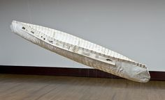 """Bonnie Devine's """"Canoe"""", mixed media and graphite on paper, thread, twine, and beads."""