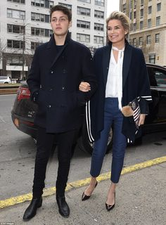 Looks run in the family, clearly: Also at the event was Gigi's brother Anwar, who Yolanda hung on to