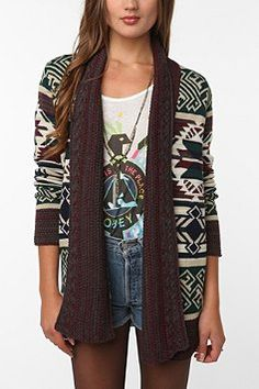 native american pattern is very cute, muted greens and reds coexist for a great subtle hint of color