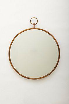 simple hoop mirror by anthropologie.