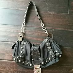 Guess handbag black with studs Gently used authentic Guess handbag.  Body is black fabric and faux leather.  The hardware is silver.  Nice size for a night out, fits all u need (cell phone, makeup extra..unlike other going out purses) the handle shoes a little sign of wear.. no trades Guess  Bags Shoulder Bags