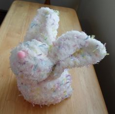 It's a bunny ... made from a square of knitted yarn!