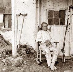 "Gettysburg, Pennsylvania John L. Burns, the ""old hero of Gettysburg,"" with gun and crutches"