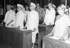 A photograph taken during the Independence Day Session of the Constituent Assembly held on August 15, 1947. Standing in the first row are Sardar Vallabhbhai Patel, Mr. K.M. Munshi, Mr. N.V. Gadgil and Mrs. Ammu Swaminathan.