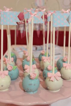 Pretty cake pops at a shabby chic baptism party! See more party planning ideas at CatchMyParty.com!