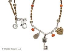 "This Sterling Silver, Brass, Glass and Coral Necklace holds the key to your heart. 17""."