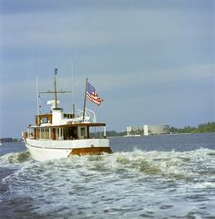 "President John F. Kennedy and First Lady Jacqueline Kennedy sail aboard the  presidential yacht ""Honey Fitz"", off the coast of Palm Beach, Florida.  Also onboard: Princess Lee Radziwill, sister of the First Lady; Gianni Agnelli,  heir of Fiat car company; Marella Agnelli, Italian socialite (January 2, 1963).  [Description courtesy of the JFK Library.] THE KENNEDY GALLERY: PAGE 3"