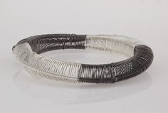 This bracelet is a part of the woven jewelry collection. Woven jewelry are representing the specific scale of our daily sentimentality, expressing them through the variety of forms and elements. It's a handmade and unique product.