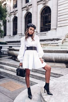 A mix of edgy and soft pieces for a New York Fashion Week outfit - white flowy dress with puffy sleeves and black accessories - black wide belt, black Saint Laurent logo heel boots, Saint Laurent leather and suede handbag, and Gucci black leather beret #outfit #dress #blackboots #beret #leatherberet #saintlaurent #whitedress #saintlaurentbag Dress Outfits, Fashion Outfits, Womens Fashion, Fashion Tips, Dresses, Fashion Websites, Fashion Stores, Fashion Photo, Fashion Trends