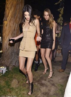 Kendall Jenner puts on a leggy display in thigh-skimming mini dress as she excitedly piles on to swing with pal Cara Delevingne at Olivier Rousteing bash | Daily Mail Online