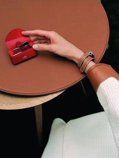 The much-anticipated Hermes Beauty makeup collection is finally here. And the first product is a line of lipsticks called Rouge Hermes, launched alongside a collection of small leather accessories to tote them around in. Lipstick Collection, Makeup Collection, Bucket Bag, Lipstick Case, Hermes Bags, Clutch, Leather Accessories, Birkin, Purses
