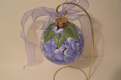 My handpainted hydrangea ornament with glittered leaves on top and a periwinkle bow