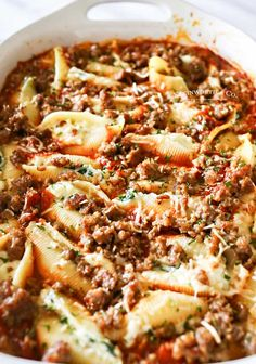 Loaded with spinach garlic sausage ricotta & smothered in marinara sauce these Stuffed Shells make a great easy family dinner idea that everyone loves. Yummy Pasta Recipes, Easy Meat Recipes, Easy Dinner Recipes, Cooking Recipes, Noodle Recipes, Dinner Ideas, Italian Dishes, Italian Recipes, Casserole Dishes