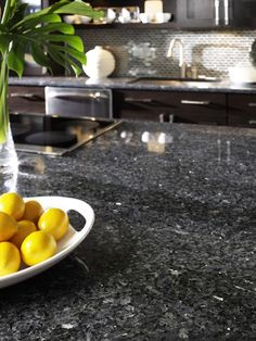 Dark granite adds a touch of luxury. The hard surface is extremely durable, and stands up well to heat and scratches. I want this in my bathroom!