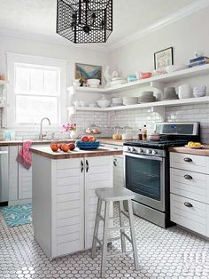 For a tiny kitchen makeover, start with an island. Small kitchens, especially th… Open Shelving, Kitchen Design Small, Kitchen Remodel, Kitchen Decor, Small L Shaped Kitchens, Open Kitchen Shelves, Kitchen Layout, Kitchen Diy Makeover, Small Kitchen Island