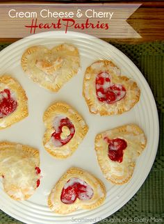 Super Easy Cherry and Cream Cheese Heart Shaped Pastries.  Perfect little hand pie for a Valentine's Day Treat!