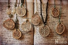 Norse wood pendants by LuthienSecrets necklace amulet jewelry cosplay costume LARP LRP equipment gear magic item | Create your own roleplaying game material w/ RPG Bard: www.rpgbard.com | Writing inspiration for Dungeons and Dragons DND D&D Pathfinder PFRPG Warhammer 40k Star Wars Shadowrun Call of Cthulhu Lord of the Rings LoTR + d20 fantasy science fiction scifi horror design | Not Trusty Sword art: click artwork for source