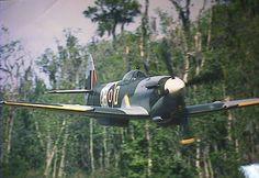 Spitfire mk xxiv. Great photo. Looks like a really low pass.