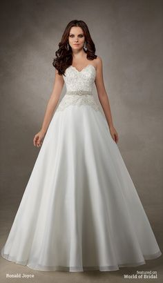 A strapless satin and beaded tulle bodice on a beautiful A-line skirt