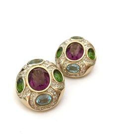Absolutely stunning Panetta jeweled clip-on earrings  - The timeless & classic design that Panetta is known for are on display with these beautiful earrings  - Composed in rich gold plated metal in a lovely oval shape  - The stones within the overall oval shape actually form a Maltese Cross  - Stunning hand-set faceted open back amethyst rhinestone center stone  - Peridot and Aquamarine hand-set open back rhinestones on either side  - Sparkling pave set clear crystal surround Measure: App...