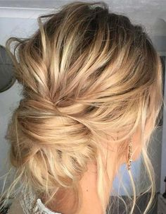 Perfectly Imperfect Updos You'll Love for Your Wedding: Low buns are a beautiful option for a little bit of a messy updo!