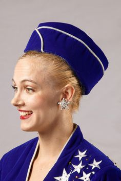 """The """"Velvet March"""" is a patriotic look designed by Deborah Newhall and was introduced by the Rockettes in 1999. This look has been worn at various milestone events. #rockettes #NYC #costumes #dancers #glamorous #white #blue #sailor #patriotic #stars #stripes #hat #earrings #velvet"""