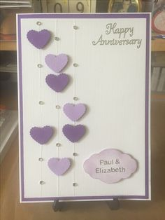 Simple Anniversary card using 2 Colours of die cut hearts. Lines put on using quickie glue pen and crystal glitter, with crystal gems. Sentiment label punched with SU punch. Idea came from another card on Pinterest