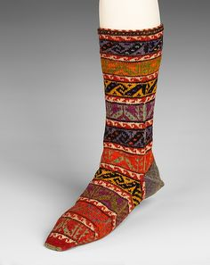 Stockings  Date: fourth quarter 19th century Culture: Turkish Medium: wool Dimensions: 17 1/2 in. (44.5 cm) Credit Line: Brooklyn Museum Costume Collection at The Metropolitan Museum of Art, Gift of the Brooklyn Museum, 2009; Brooklyn Museum Collection Accession Number: 2009.300.2663 - Afterthought heel is plain, rest of sock is patterned. Three motifs are repeated, with the colors changed as it goes.