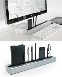 Desk Rail = elegant way to organize your desk. Has cable channel for charging devices, too.