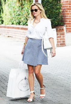 Reese Witherspoon Style: Alice + Olivia Piece & Co. Vernon Jacquard Flared Skirt; Ralph Lauren Ricky Drawstring Bag, White Shirt.
