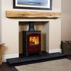 The rustic square oak beam mantel shelf showcases a beautiful chunky, rustic appearance with hand-scalloped edges for a truly traditional style. Wood Burner Fireplace, Oak Mantle, Wall Mounted Fireplace, Rustic Fireplace Mantels, Wooden Fireplace, Wood Mantels, Mantel Shelf, Mantles, Fireplace Ideas