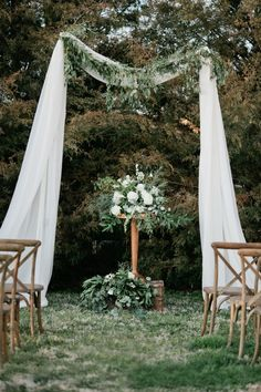 Great way to utilize the natural beauty of the trees with a simple but elegant touch of fabric.